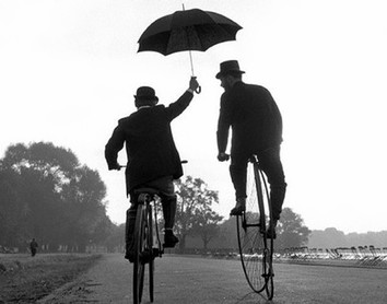 Cycling in the rain with an umbrella to stay dry