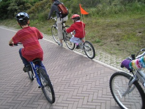 Family cycling on paved path