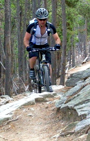 Climbing rocks on a mountain bike
