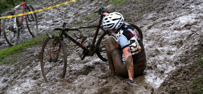 A cyclocross rider stuck in the mud