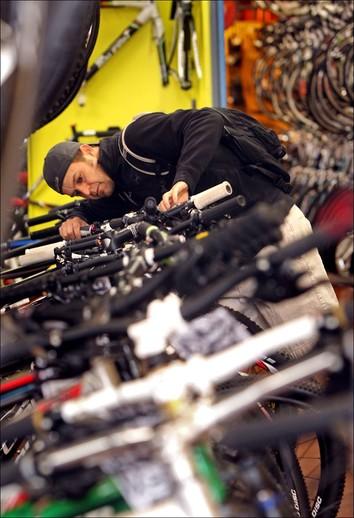 local bike shop staff learning new technology