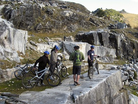 mountain bike adventure on rocky outcrop