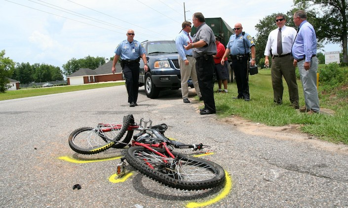 Bicycle accident aftermath with police investigators