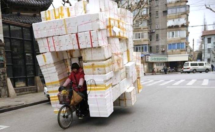 Overloaded bicycle in China