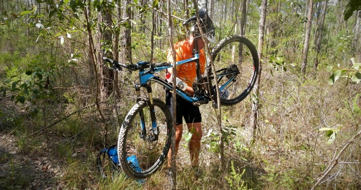 Bush Mechanic - Using tree as a bicycle repair workstand