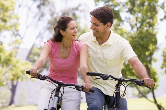 A happy bike riding couple