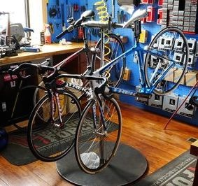 Carbon bikes on a workstand at Milltown Cycles