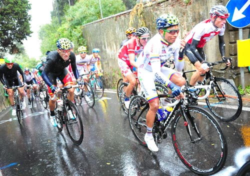 Cycling professionals race in the rain