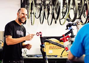 Smiling happy bike mechanic
