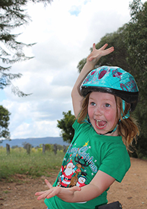 excited kid wearing bike helmet