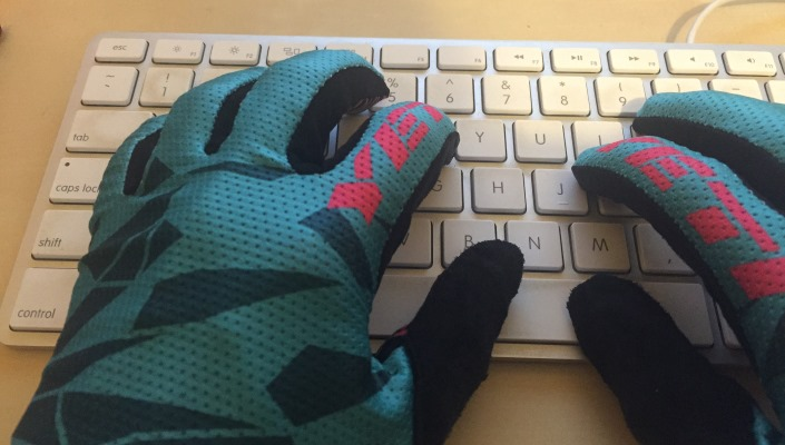 BikeRoar writer Jayne Rutter types in her Yeti gloves.