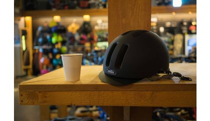 Nutcase Metroride MIPS bicycle helmet and a cappuccino at a bike and coffee shop