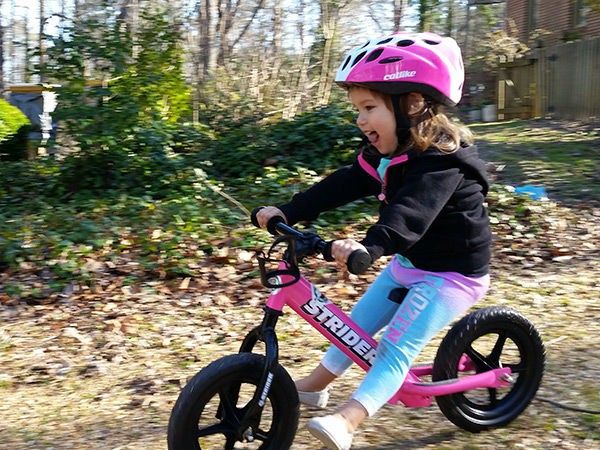 Girl loving her Strider balance bike