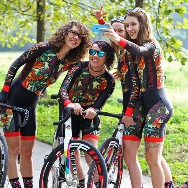 Women cycling friends selfie