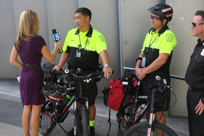 LAX bicycle medics being interviewed by local TV crews