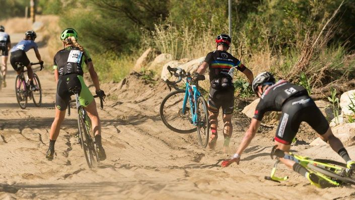 Cyclists struggle through a sand pit at the Belgian Waffle Ride
