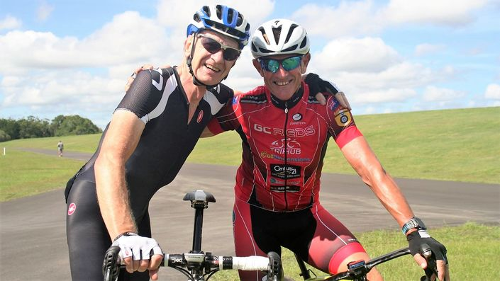 Two masters cyclists smiling on a ride