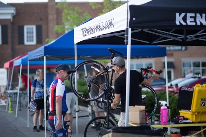 Kenda's Director of Marketing, Ben Anderson, helping prepare riders bikes before the Honor Ride.