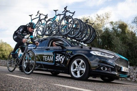 Loaded roof rack on the car of pro cycling's Team Sky