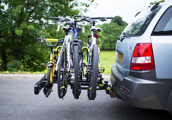 Hitch mount bike rack carries four bikes in separate cradles