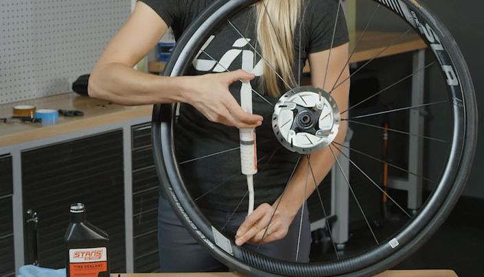 Injecting sealant for a road tubeless tire setup