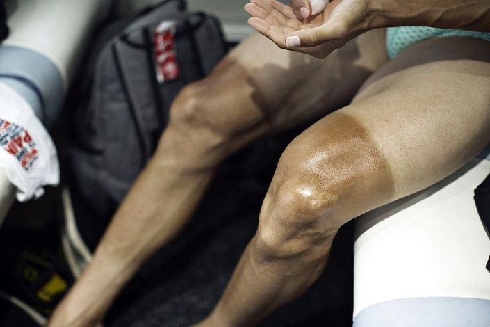Shaved legs of Martin Elminger (IAM Cycling) are ready for a massage