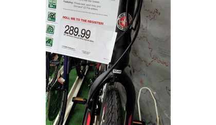 Schwinn hybrid bike with fork installed backwards (in spite of helpful labeling!). via @unstagrum.