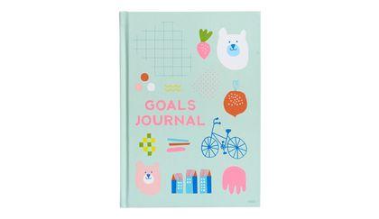 Write down your goals in a kikki.K A5 Goals Journal