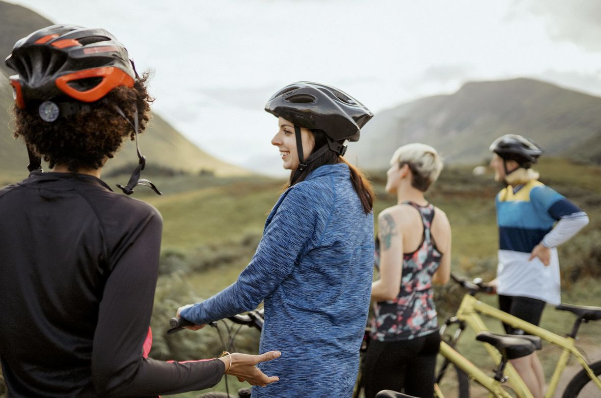 A group of female cyclists enjoying the view