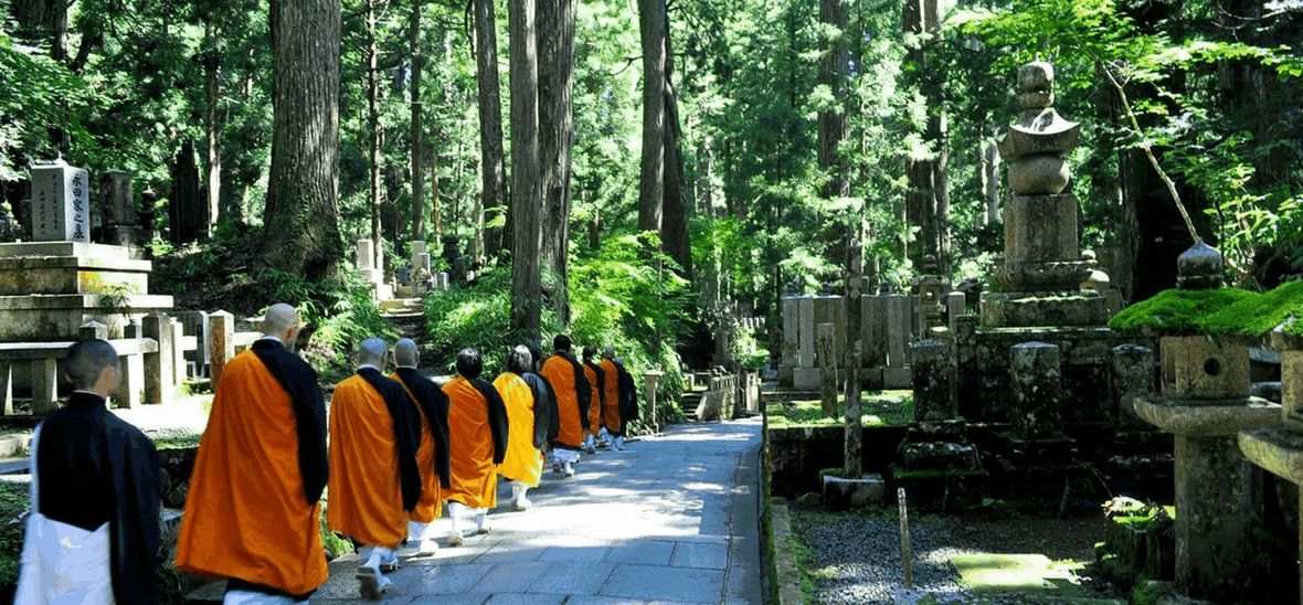 Monks walking in line through temple grounds